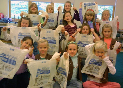 Brownie Troop #2770 preparing bags for the 2009 Scouting for Food Drive (contributed photo)