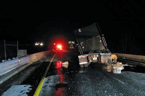 Late night truck crash on I-495 creates a mess