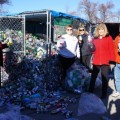 Volunteers from SEF and other charities collect recycled cans at the Transfer Station for redemption