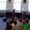 Sciencetellers entertained and educated last summer at the Library (image cropped from Facebook)