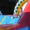 Inflatable obstacle courses make kids smile (by Beth Melo)